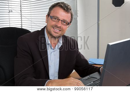 a Handsome man at his desk working