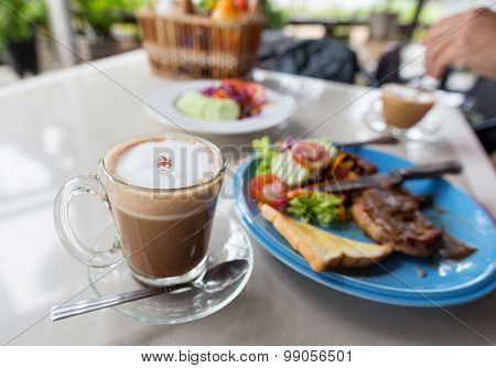 Coffee And Steaks On The Table.