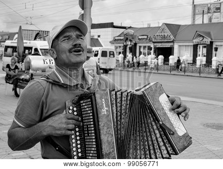 Blind Accordion Player Plays For Money
