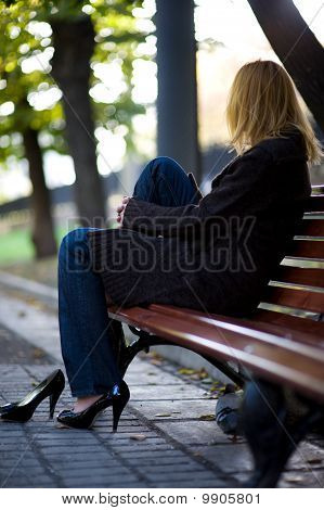 woman sitting on a bench in the park
