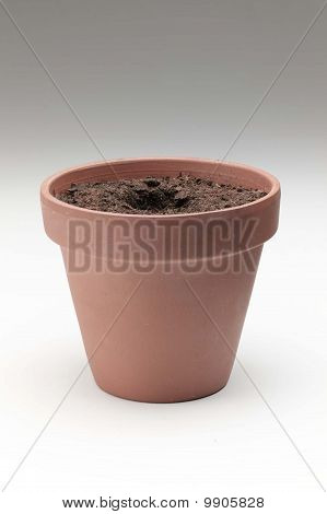 clay pot with dirt