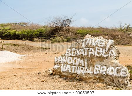 Directions Painted On Rock In Curacao