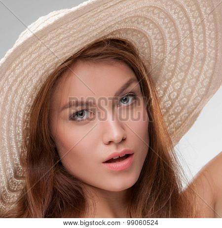 Beautiful girl with broad-brim