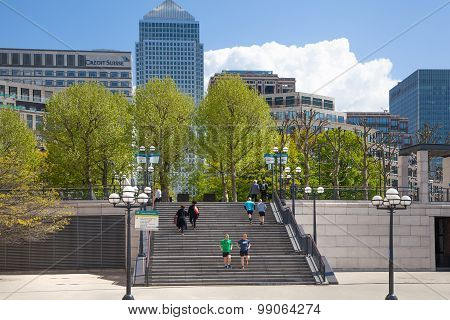 London, Canary Wharf banking aria. Stairs up to the square with walking people