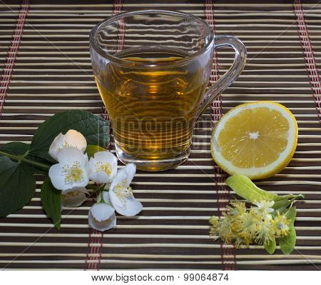 Lime Tea, Lemon And Flower On A Decorative Rug