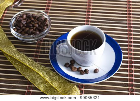 Black Coffee And Grains Of Coffee On A Saucer