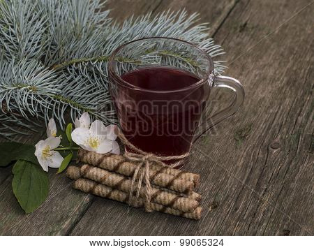 Transparent Cup Of Tea, Fir-tree Branch And Floret