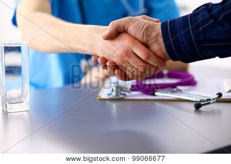 doctor with stethoscope on the patient's admission at the table