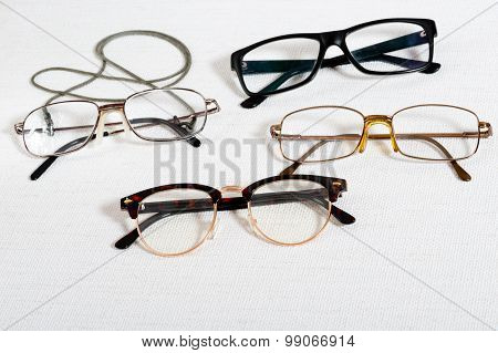 Reading Glasses On The White Table
