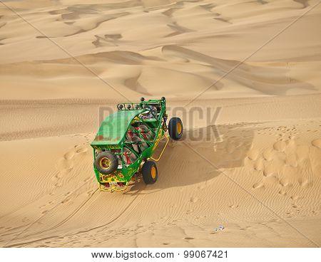 Buggy on sand dune