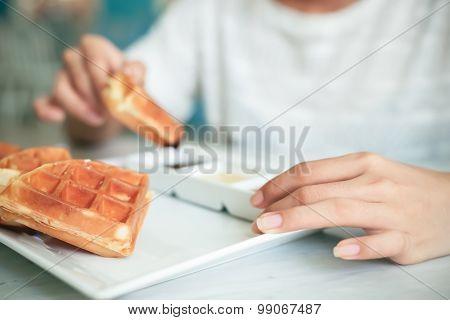 woman eating waffle