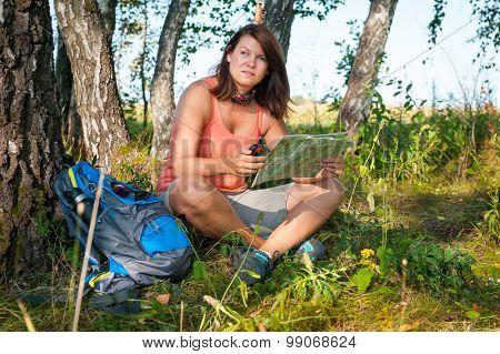 Young woman exploring the trekking map