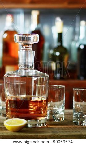 The Decanter Of Whiskey And Two Empty Glasses