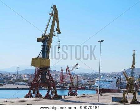 Cargo Cranes And Ship In The Sea Port Over Blue Sky