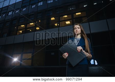 Successful Beautiful Young Business Woman Standing On Background Buildings.