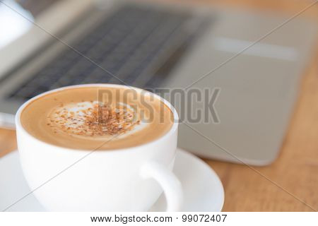 laptop with coffee cup on old wooden table ( Filtered image processed vintage effect. )