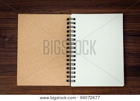 Blank notebook mock up on wood background