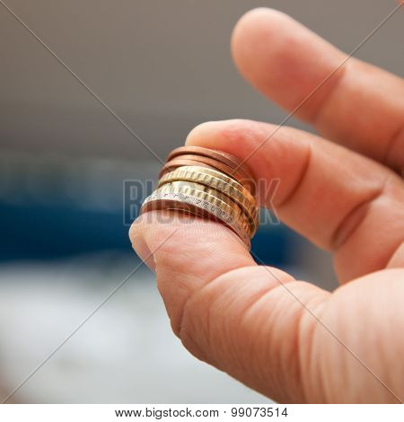 Hand With Euro Coin Stack