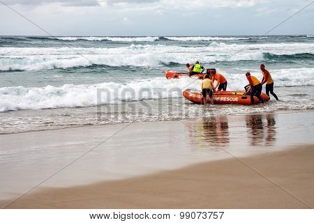 Surf life savers training in surf rescue boats