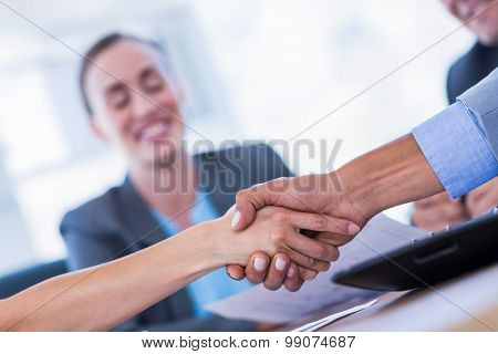 Business people shaking hands during meeting in office