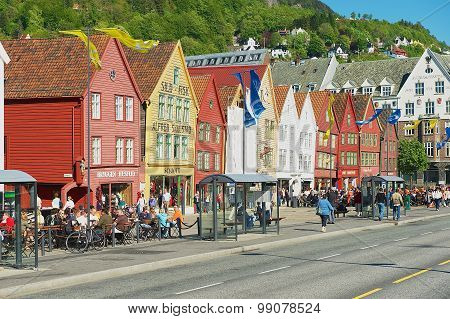 People walk by Bryggen in Bergen, Norway.