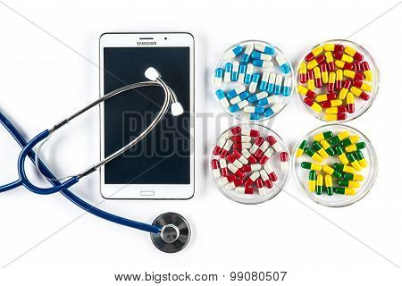 Pills And Stethoscope With Tablet, Capsule In Pill Container