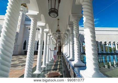 Woman Walking In Mosque Of Sultan Omar Ali Saifuddin  In Brunei