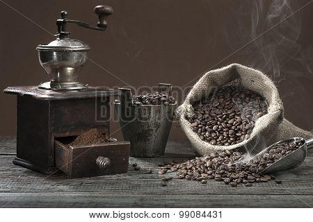 Fresh roasted smoking coffee beans in burlap sack.
