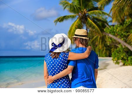 Happy young couple on tropical summer beach