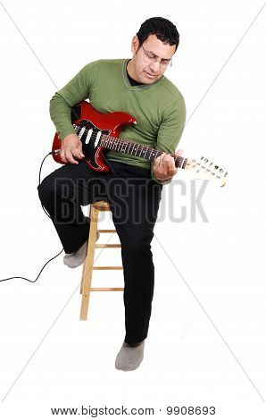 Man Sitting With Guitar.