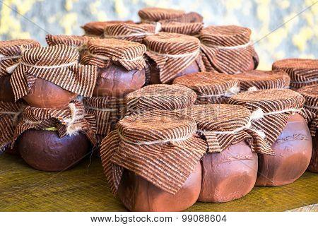 Image of clay brown honey pots