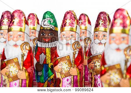 Close-up of Sinterklaas and Black Pete . Saint  Nicholas chocolate figure of  Dutch character of Santa Claus.Isolated on white background.