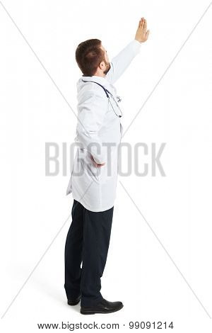 back view of doctor in white smock raising his hand up and showing stop sign. isolated on white background