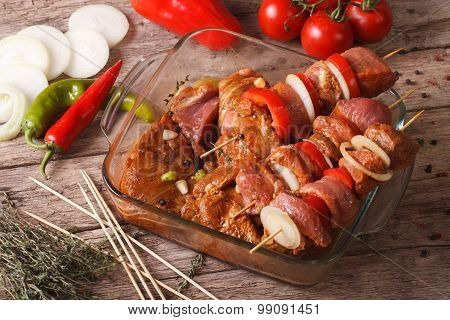 Raw Kebab With Vegetables In A Spicy Marinade Horizontal