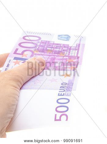 Hand holding 500 euro note