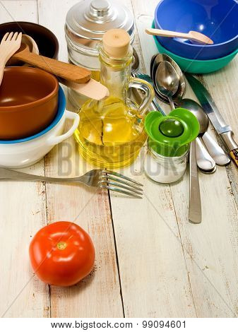 crockery and tomato on green background closeup