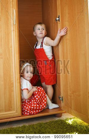 boy with girl playing hide and seek