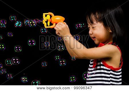 Asian Chinese Little Girl Playing Soap Bubbles