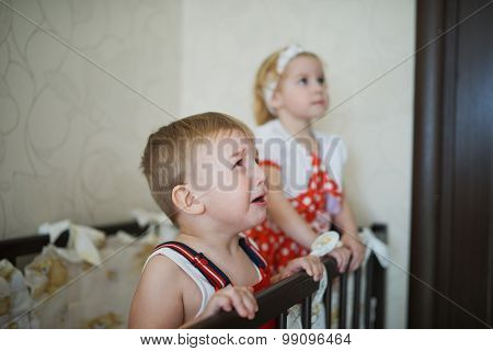 boy with girl in cot