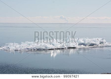 Ice Piles on Sandbar in Lake