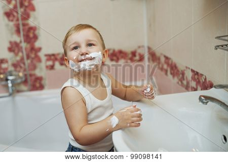 boy playing with shaving foam
