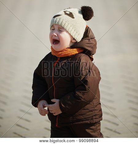 portrait of cute crying boy