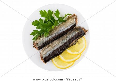 Canned Saury With Lemon And Parsley In Glass Plate