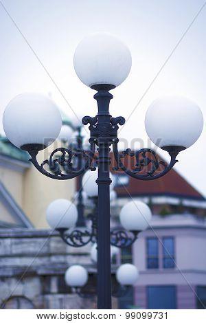 Street lighting. An old street lamppost .