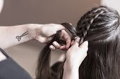 Постер, плакат: Hairdresser Making A Braid