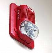 stock photo of fire-station  - A fire alarm with built in strobe light to alert in case of fire - JPG