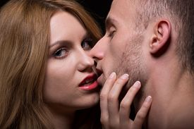 image of seduce  - Sexy look of provocative woman seducing a man - JPG