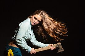 stock photo of independent woman  - Sexy seductive woman holding axe chopper - JPG
