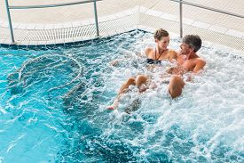 foto of thermal  - Couple in thermal wellness spa on water massage enjoying the treatment - JPG