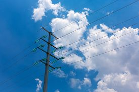 picture of electricity pylon  - Electricity pylon tower structure against blue sky - JPG